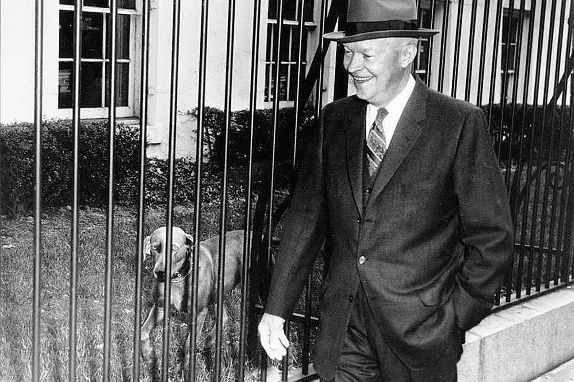 Photograph of Dwight D. Eisenhower and dog