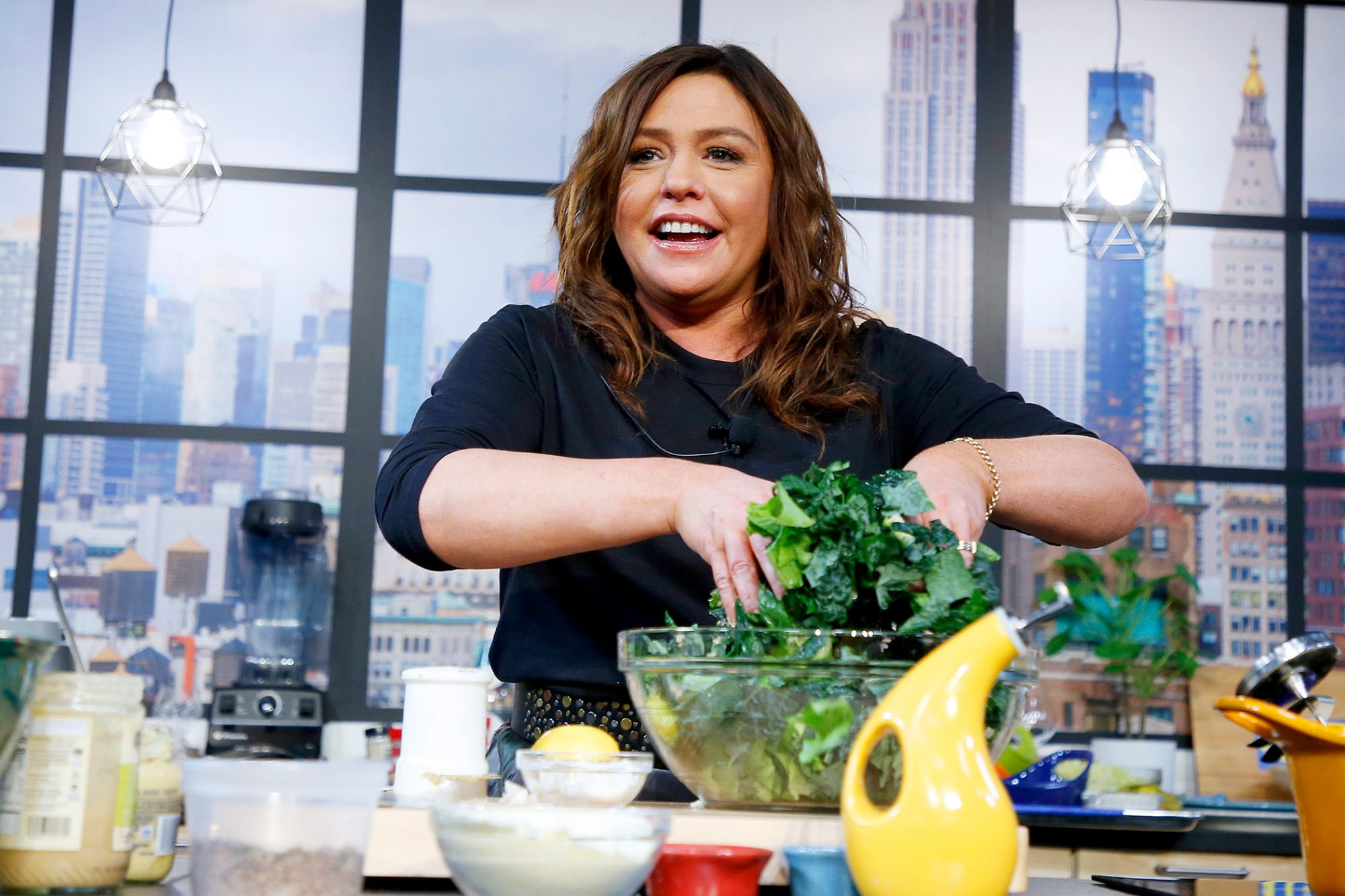 Rachael Ray tossing a salad on her set