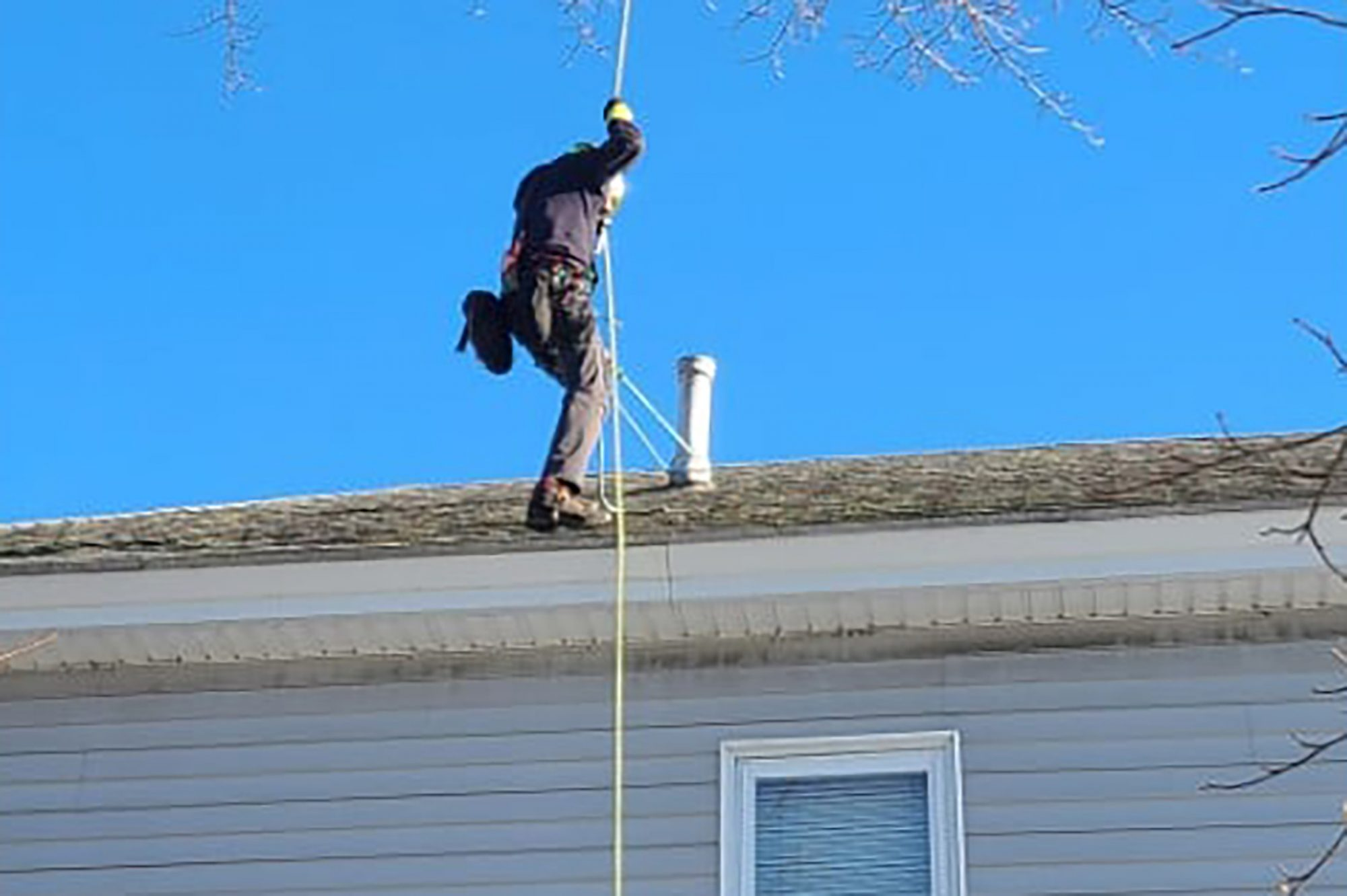 Man lands on roof from below
