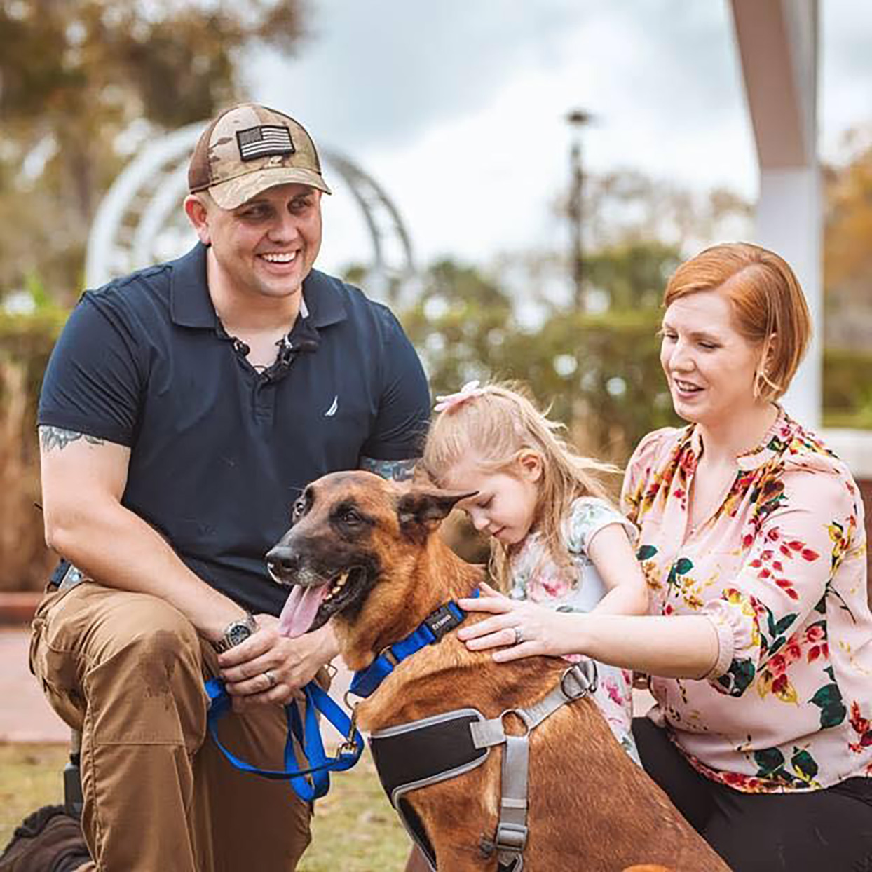 Staff Sgt. Charles Ogin and family are reunified with military work dog Rrobiek