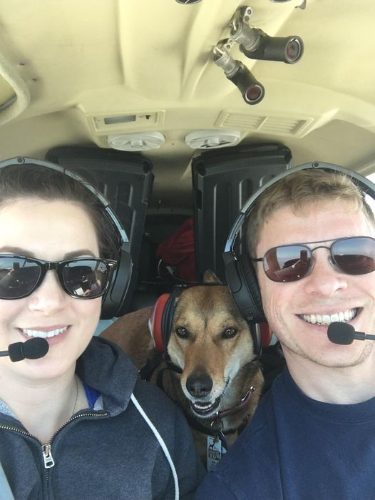 Linda, Dogs on Deployment 2021 mascot, takes flight with her smiling humans