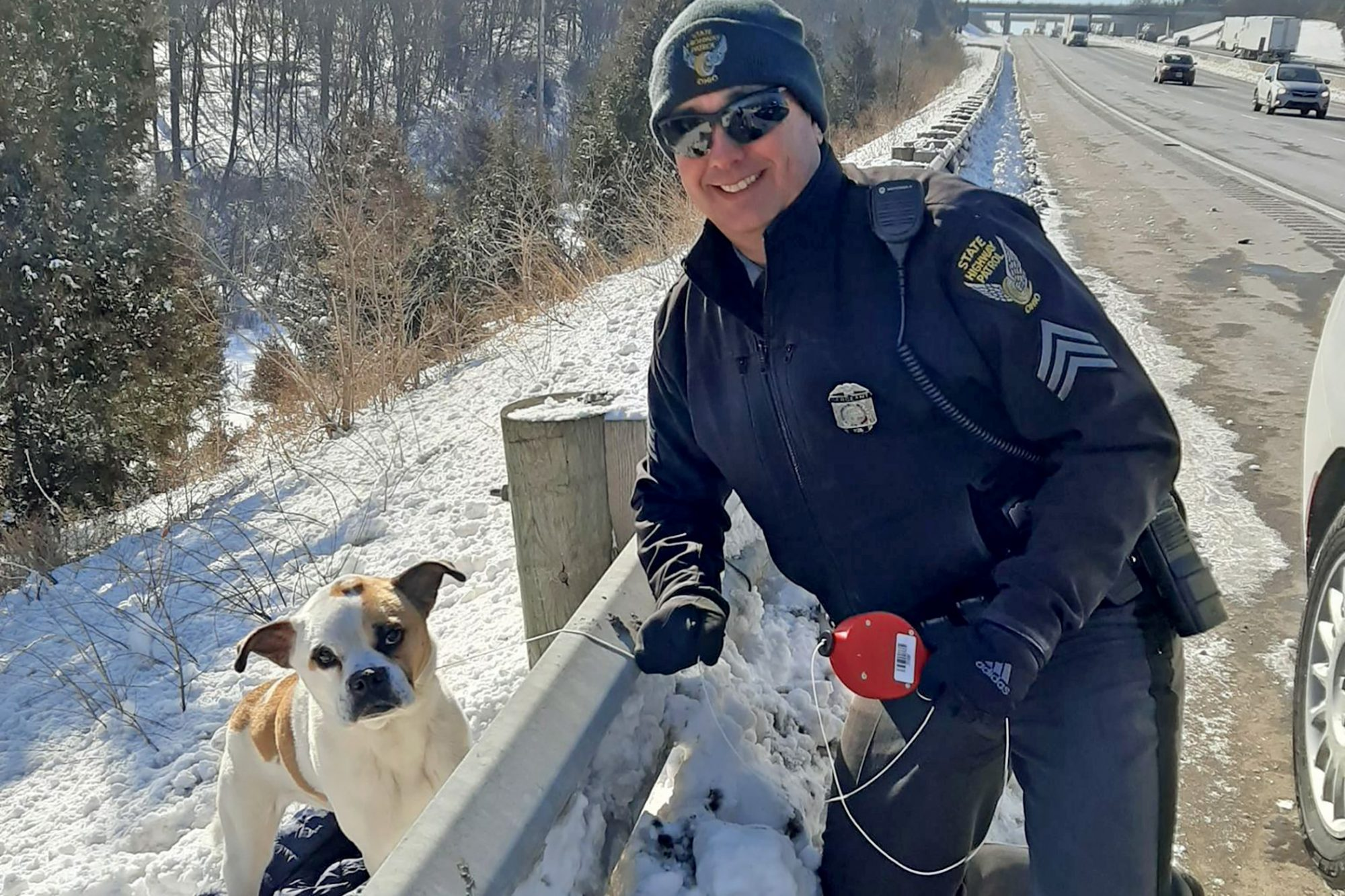 dog that was lured by lunchmeat with officer that helped him