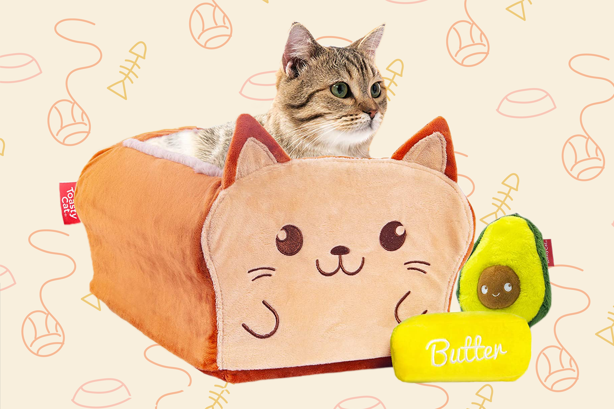 Product photo of Toasty Cat cat bed with cat inside featuring a loaf of bread with cartoon cat face and extra butter and avocado toys