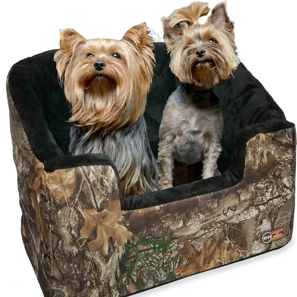 Two dogs sitting in a K&H Pet Products Large Bucket Booster seat against a white background