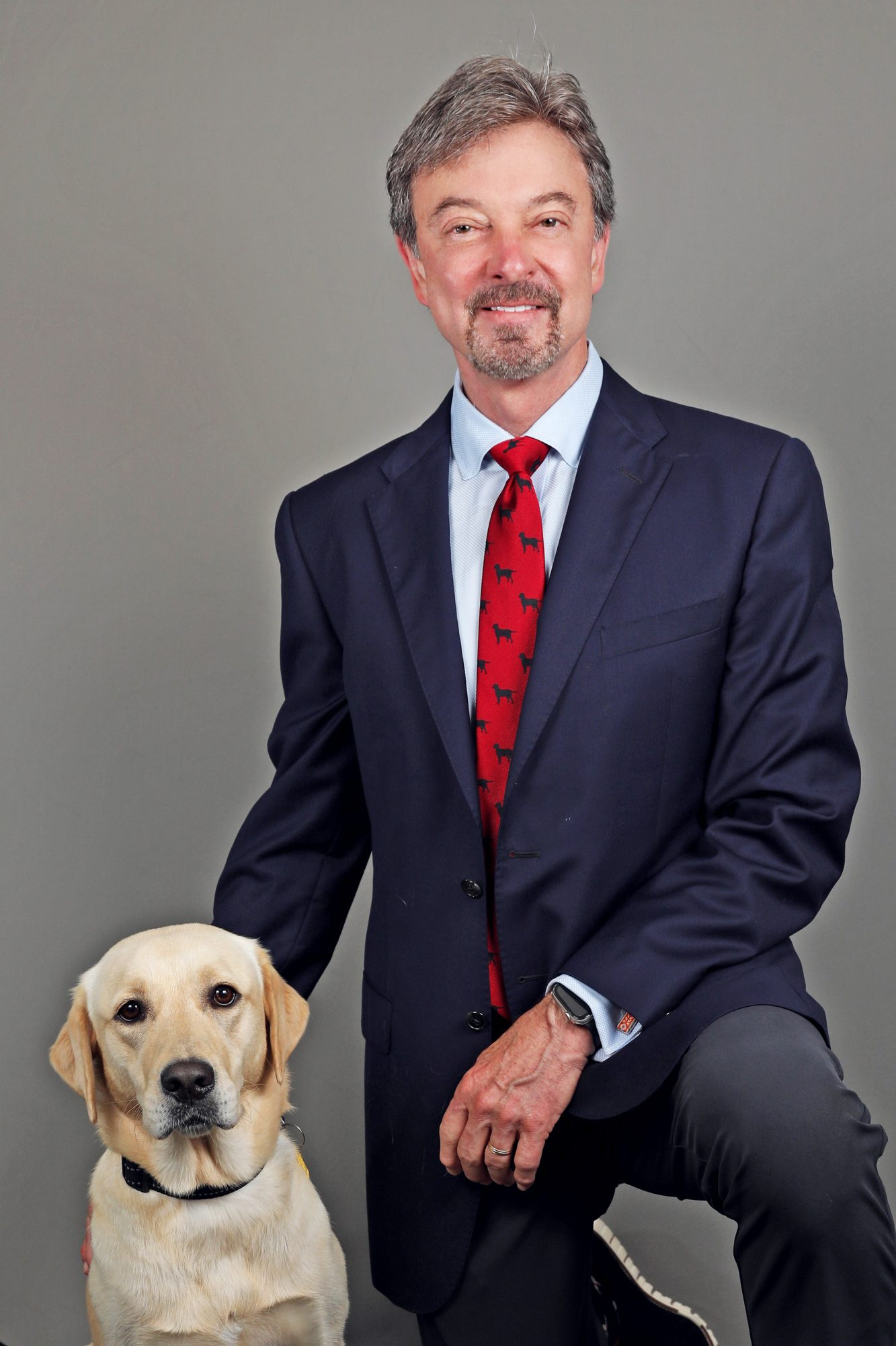 covid sniffing dog Buffy with his owner and Sarasota-Manatee, Doctors Hospital CEO Bob Meade