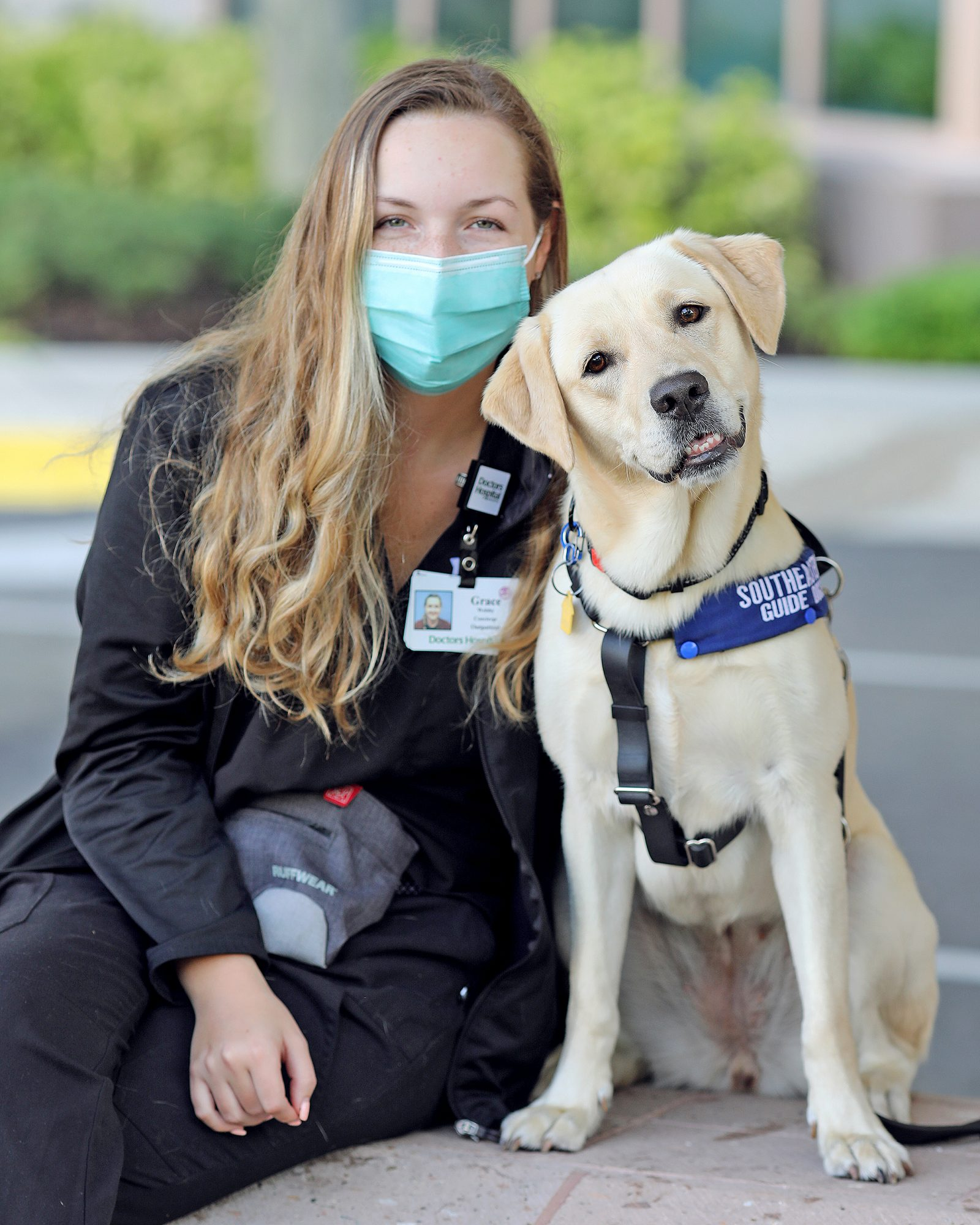 Buffy the covid sniffing dog and his handler Grace Welsby