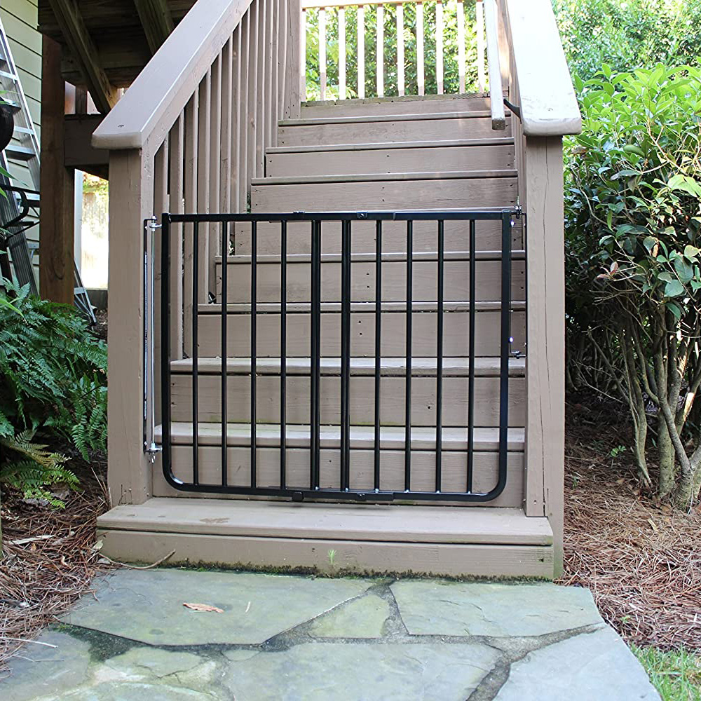 Cardinal Gates Outdoor Safety Gate installed on an outdoor deck stair