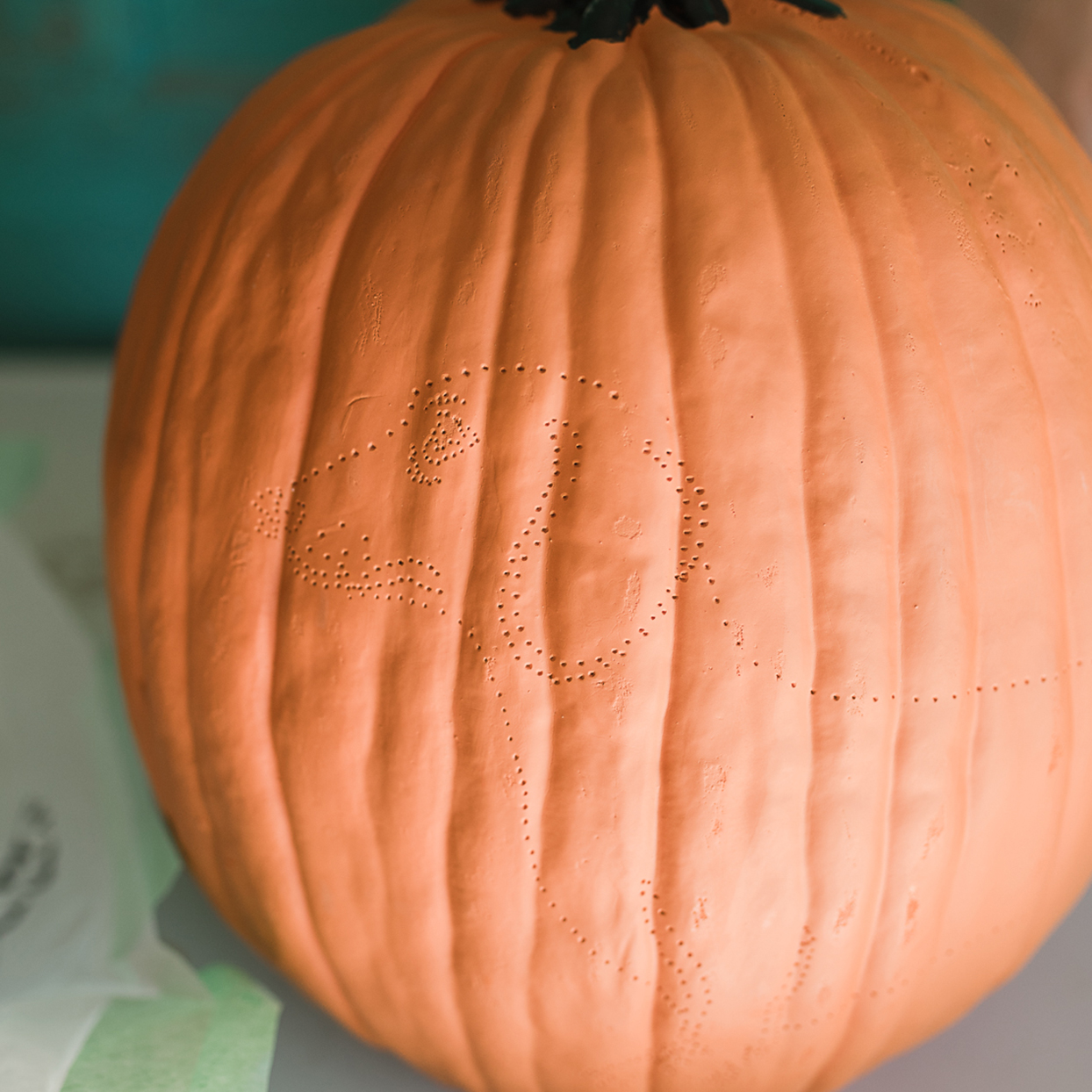 pumpkin carving with pin points in the shape of a dog