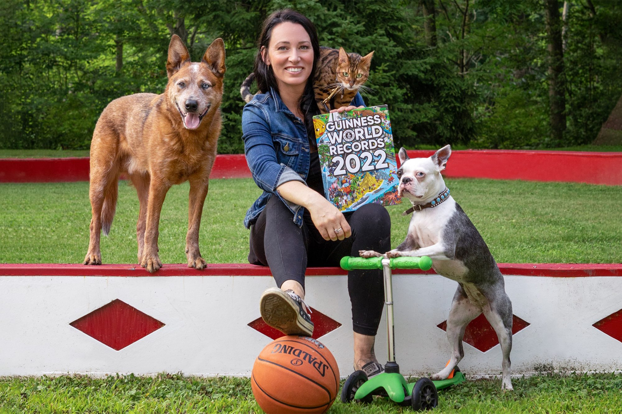 Recipients of the Guinness scooter record, including two dogs and a cat