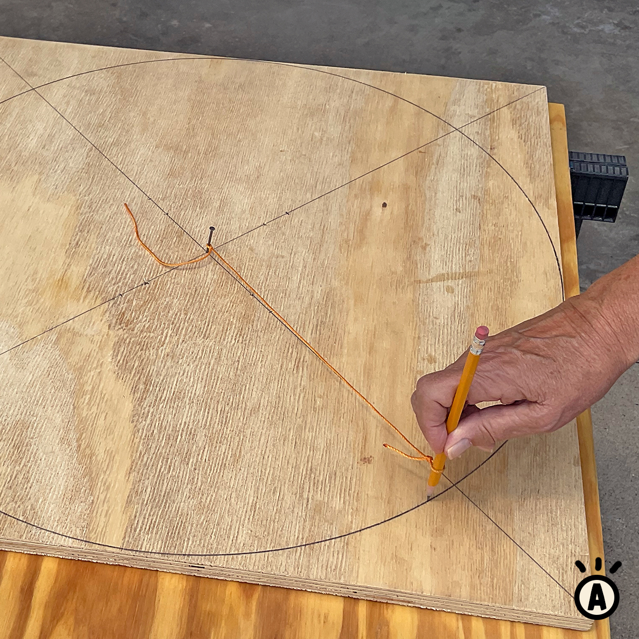 diy cat scratcher how-to step a drawing a circle onto wood using pencil and string