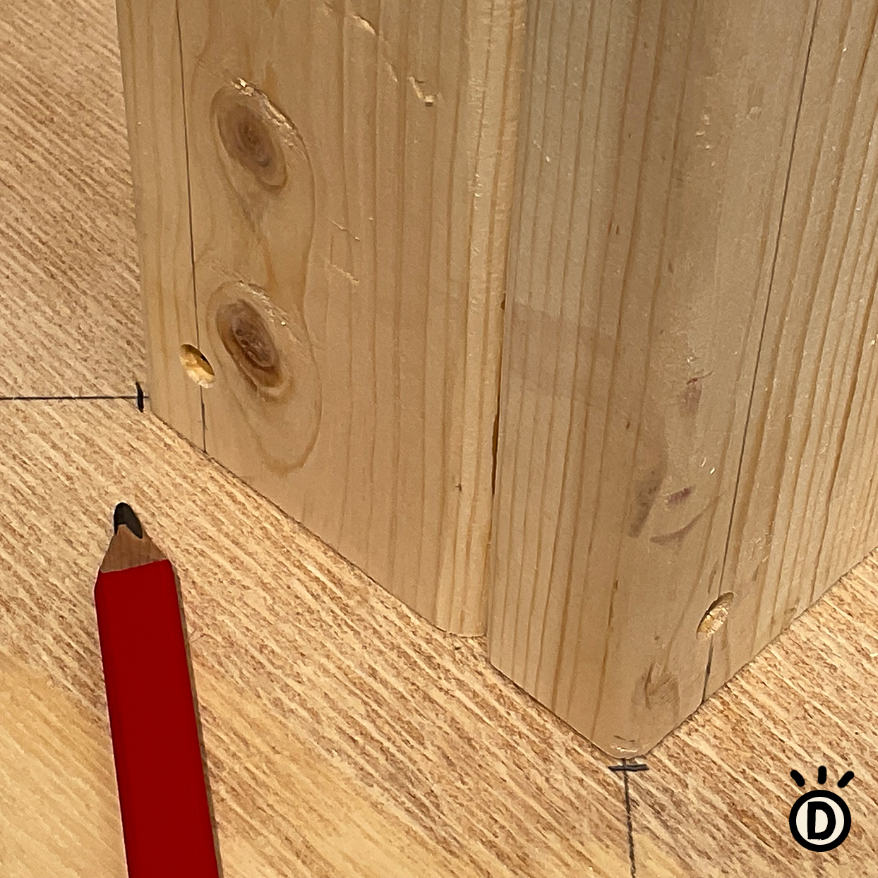 diy cat scratcher how-to marking wood center post with a pencil