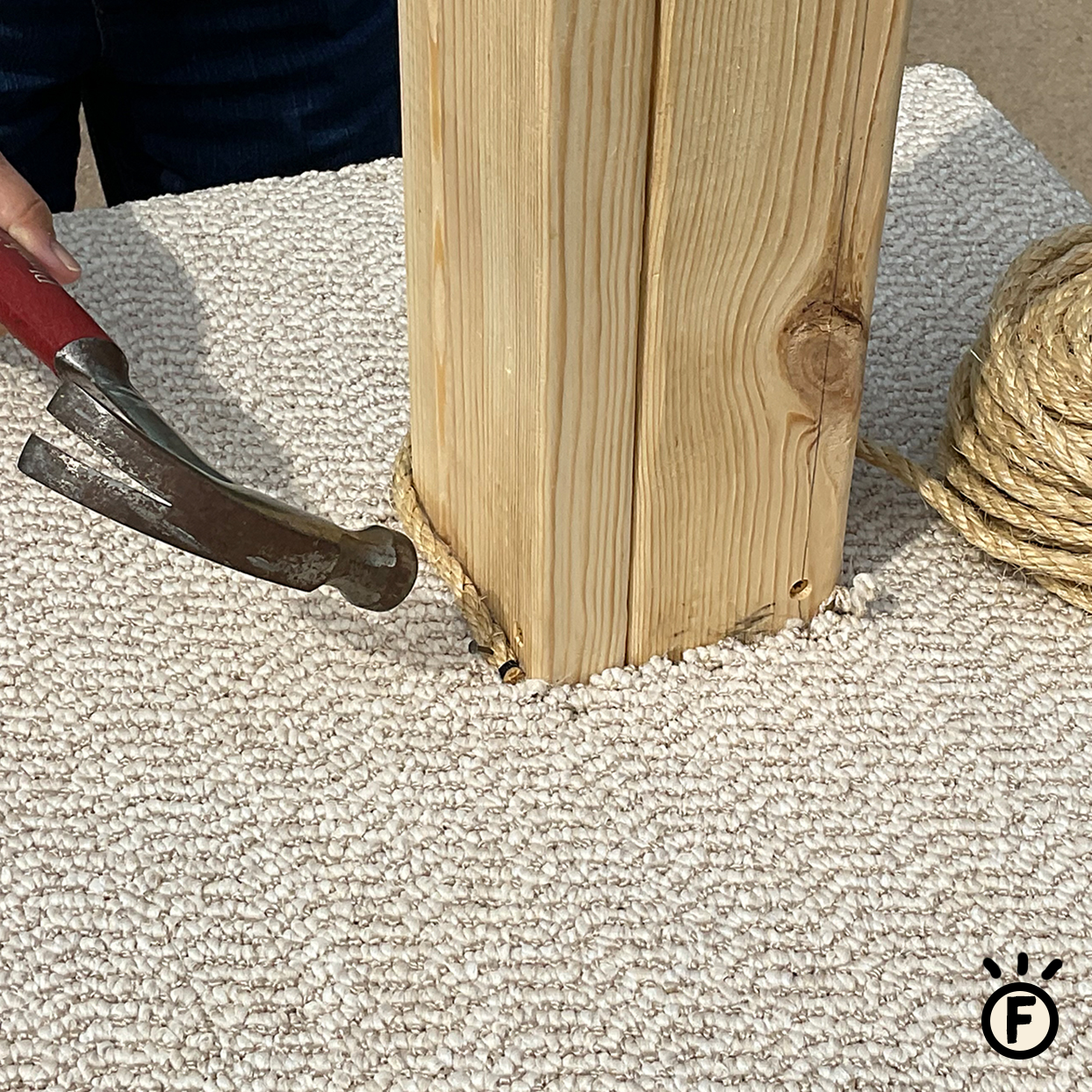 diy cat scratcher step f nailing rope onto wood post