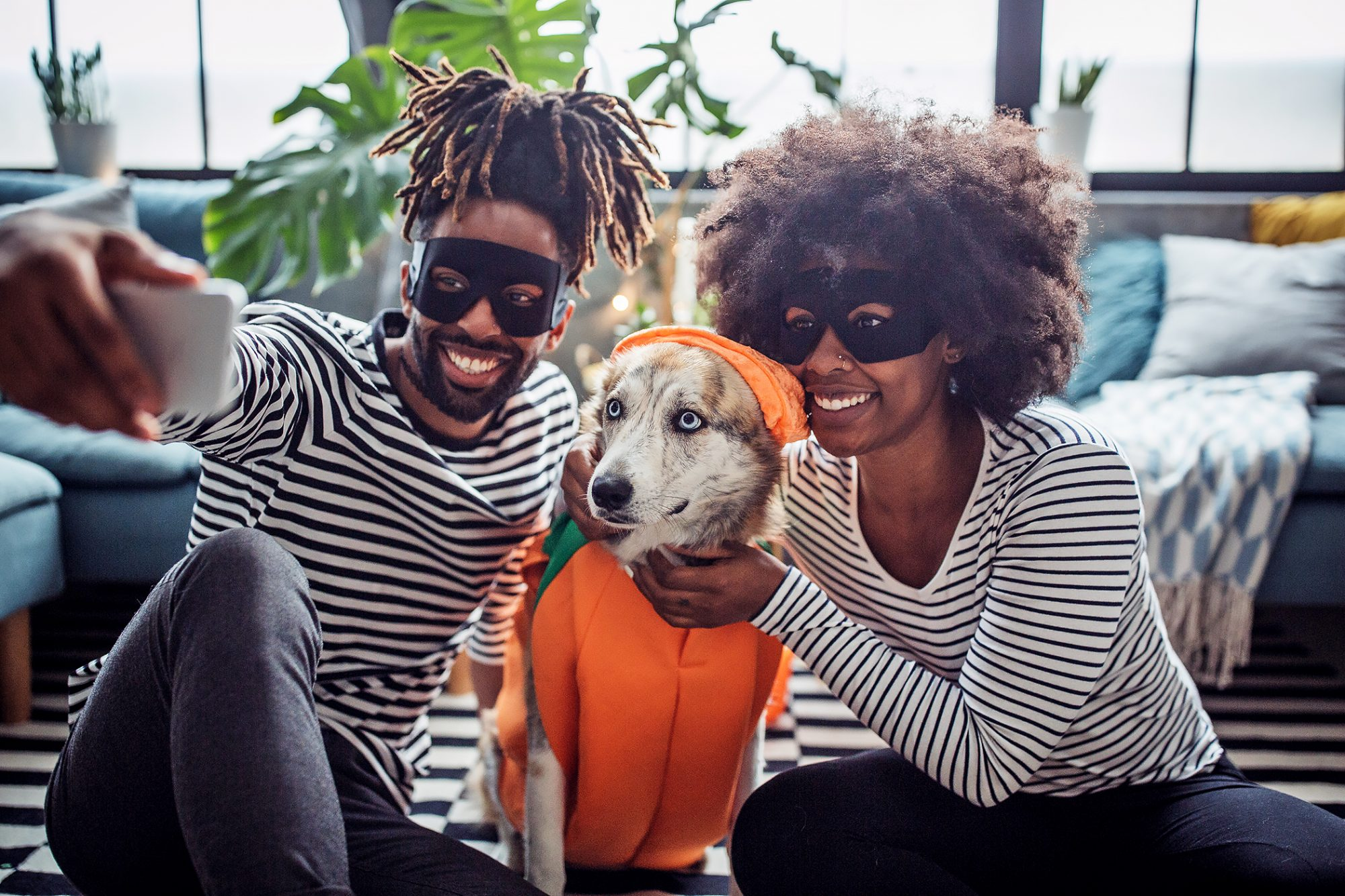 couple with large dog in Halloween costume