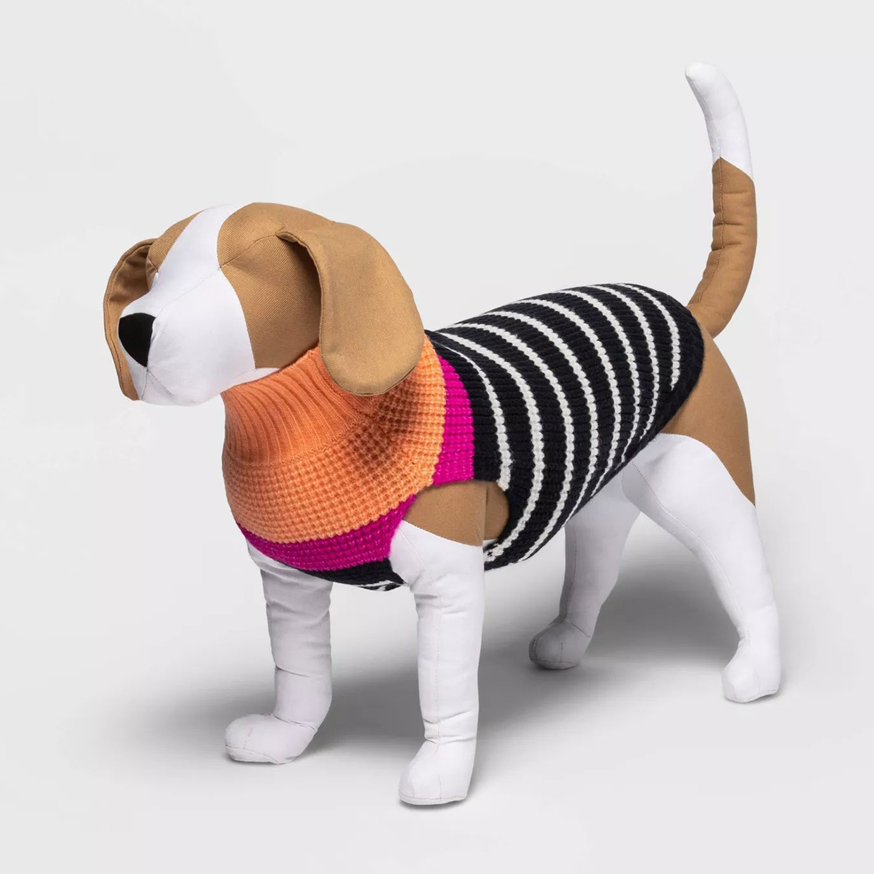 Toy plush dog wearing a Boots & Barkley™ Holiday Striped Sweater on a gray background