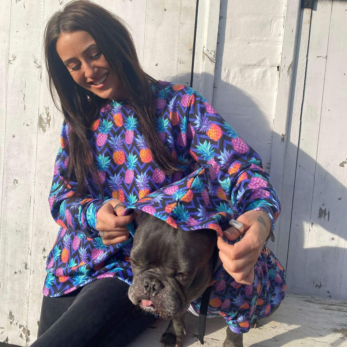 Woman and dog wearing Doggieo Matching Dog and Owner Sweater Set