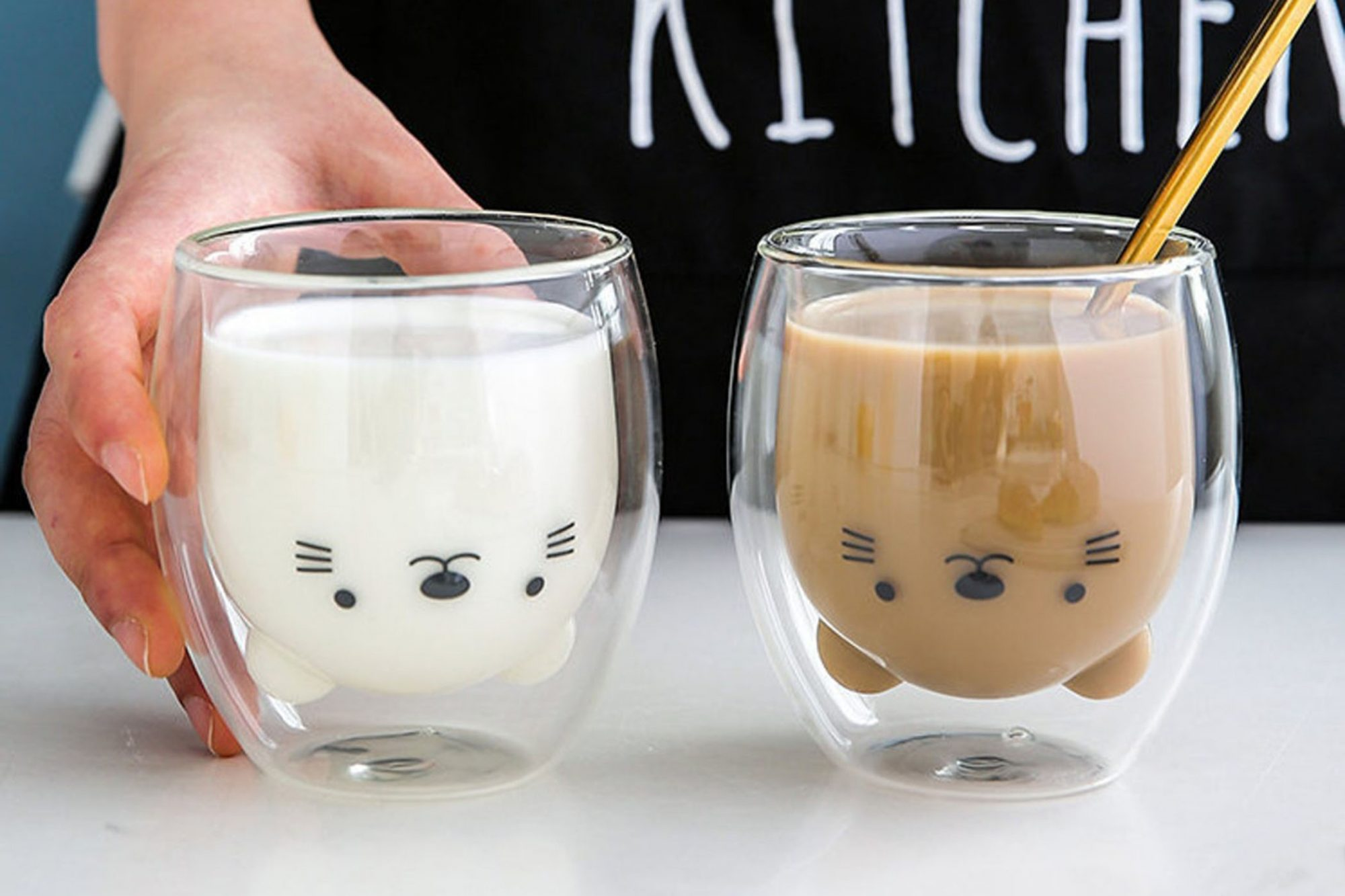 clear cat mugs holding with milk and coffee