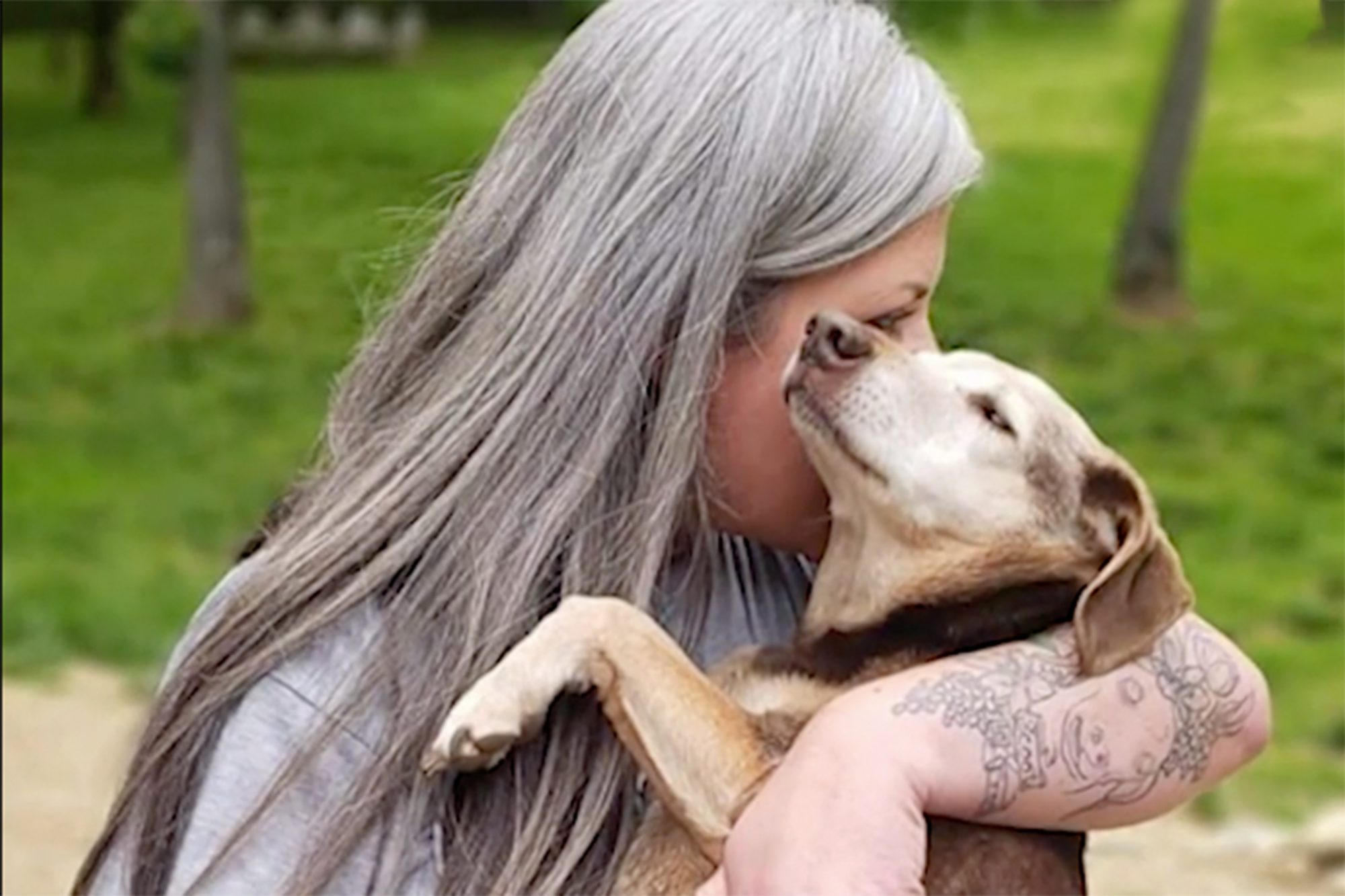 Valerie Reid with a dog from her senior dog sancutary Whispering Willows