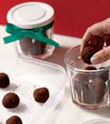 Chocolate balls in decorative glass containers