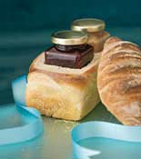 Containers of Jams in loaf of bread