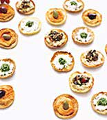 Crackers with spread and veggies on top