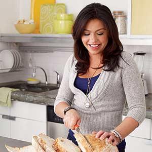 Rachel Cutting Bread