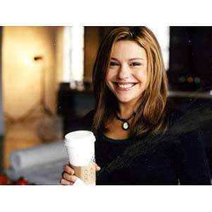 Rachel Holding a Container of Coffee