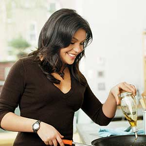 Rachel Putting Olive Oil in Pan