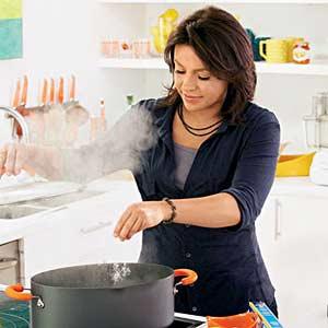 Rachel Sprinkling Salt in Pan