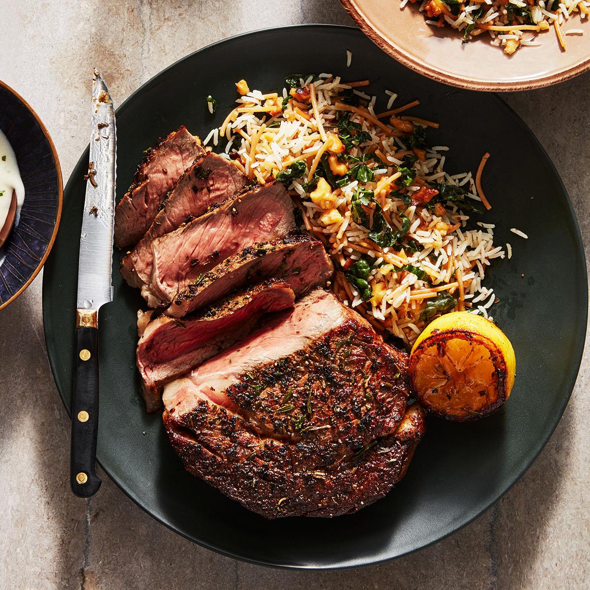 Rachael Ray's Rib Eye Steaks with Gorgonzola Sauce & Kale-Walnut Vermicelli Rice
