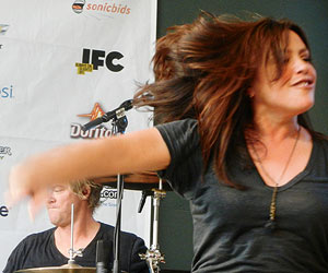 Rachael on stage with Train