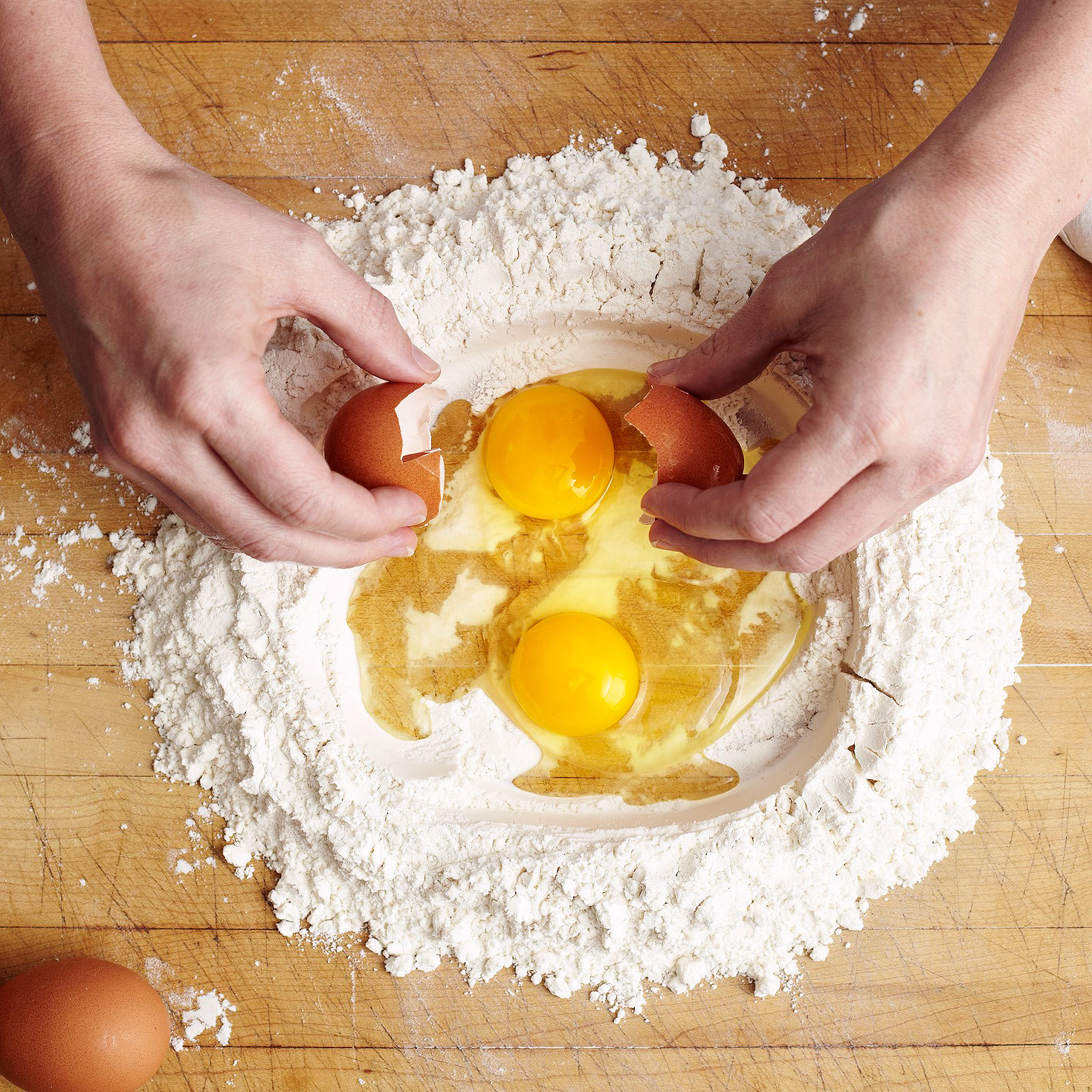 cracking eggs into four well
