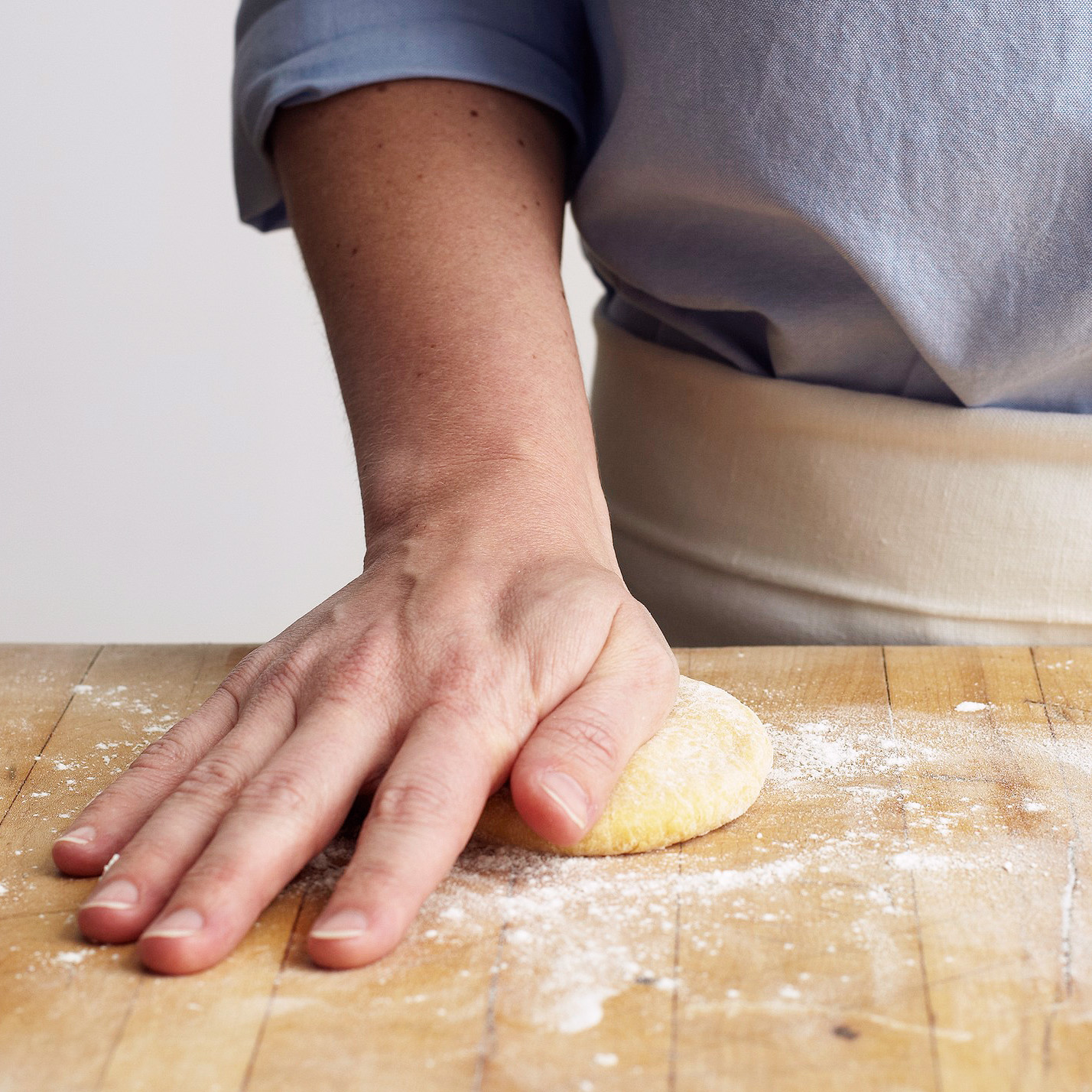 flatten pasta dough with palm of hand