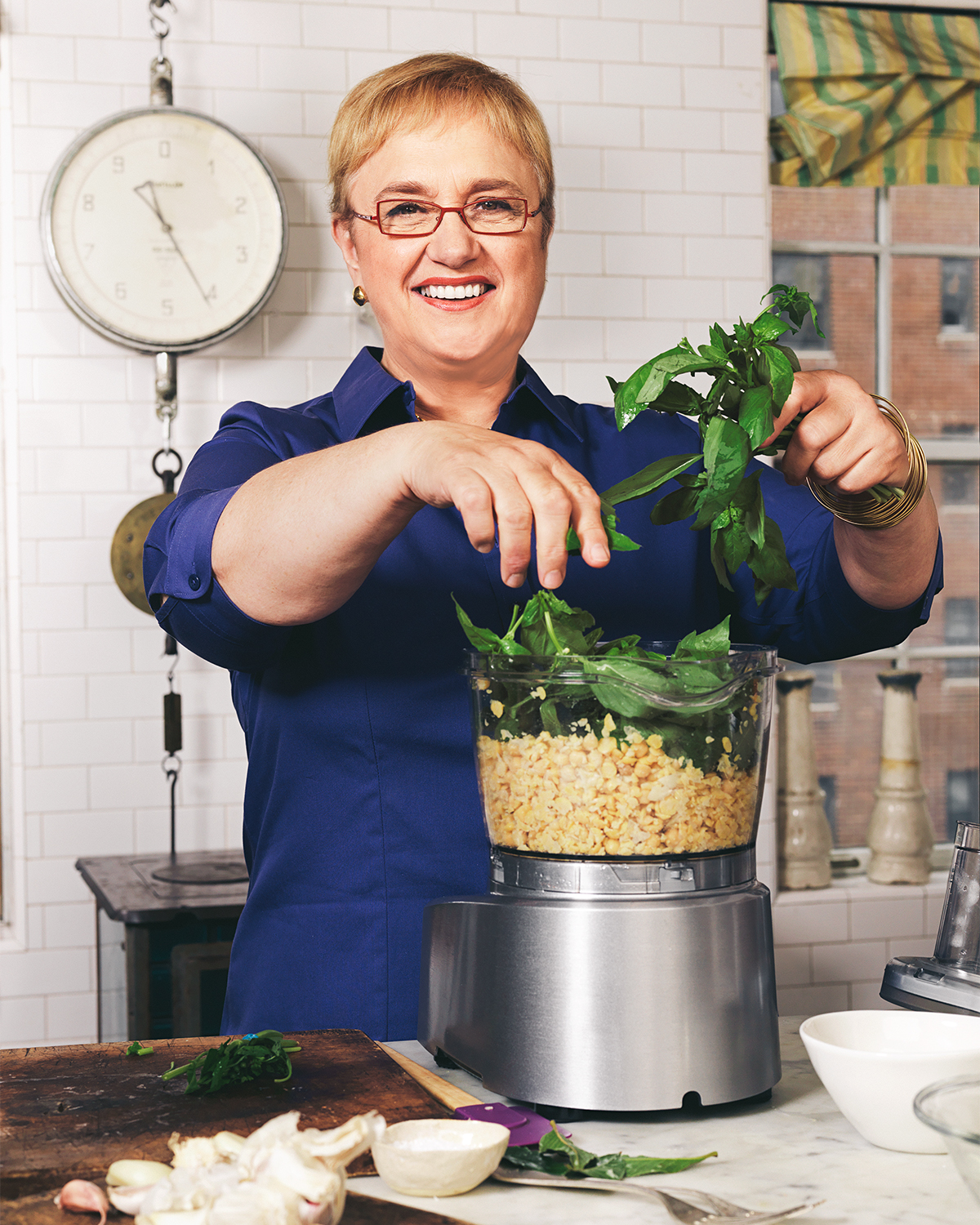 Lidia using food processor for herbs and chickpeas