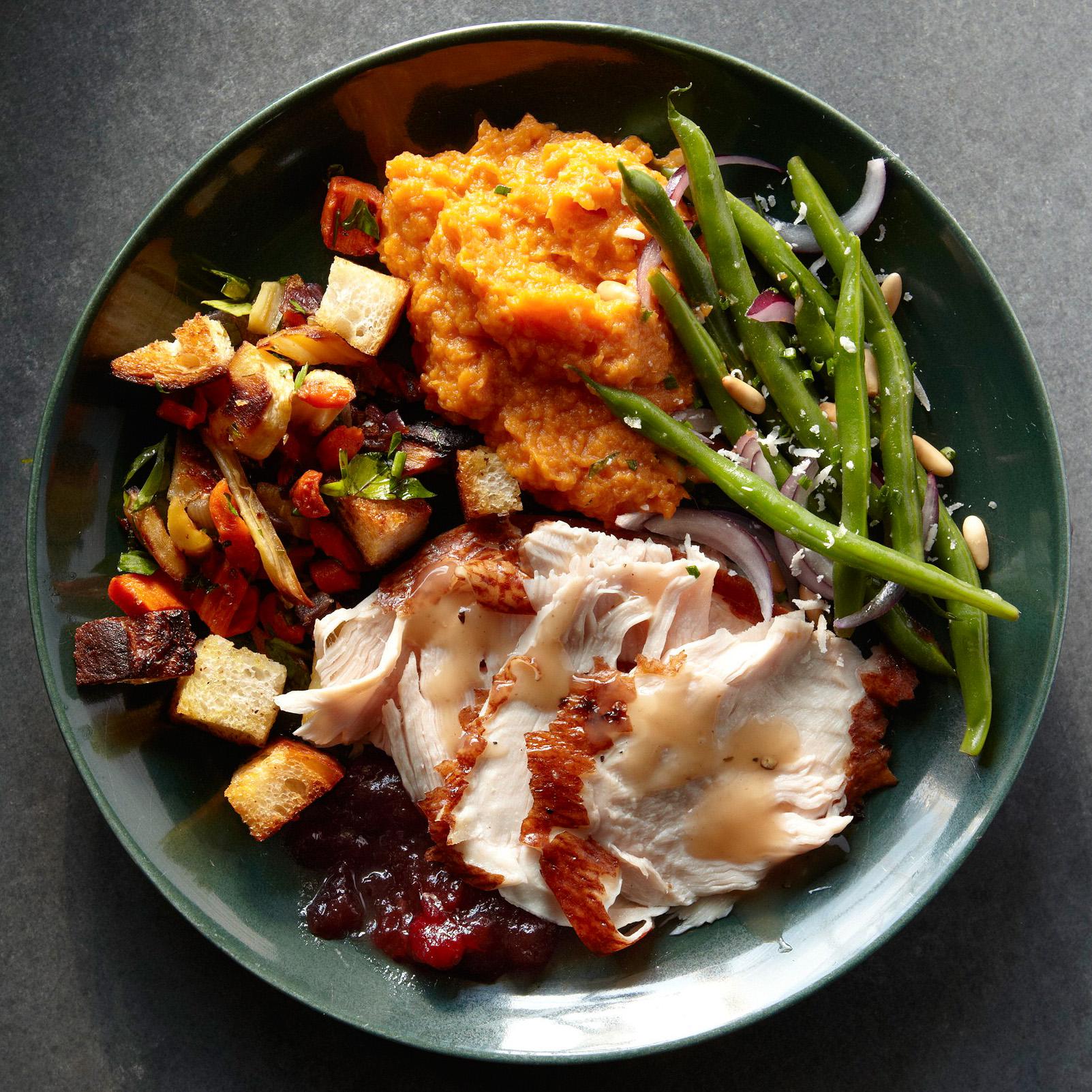 stuffing, turkey, green beans, sweet potatoes on plate