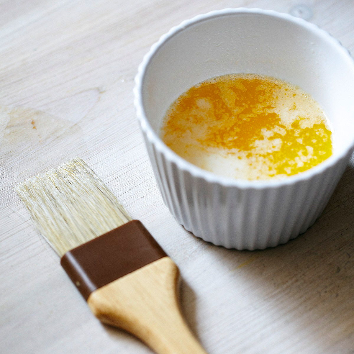 melted butter in dish