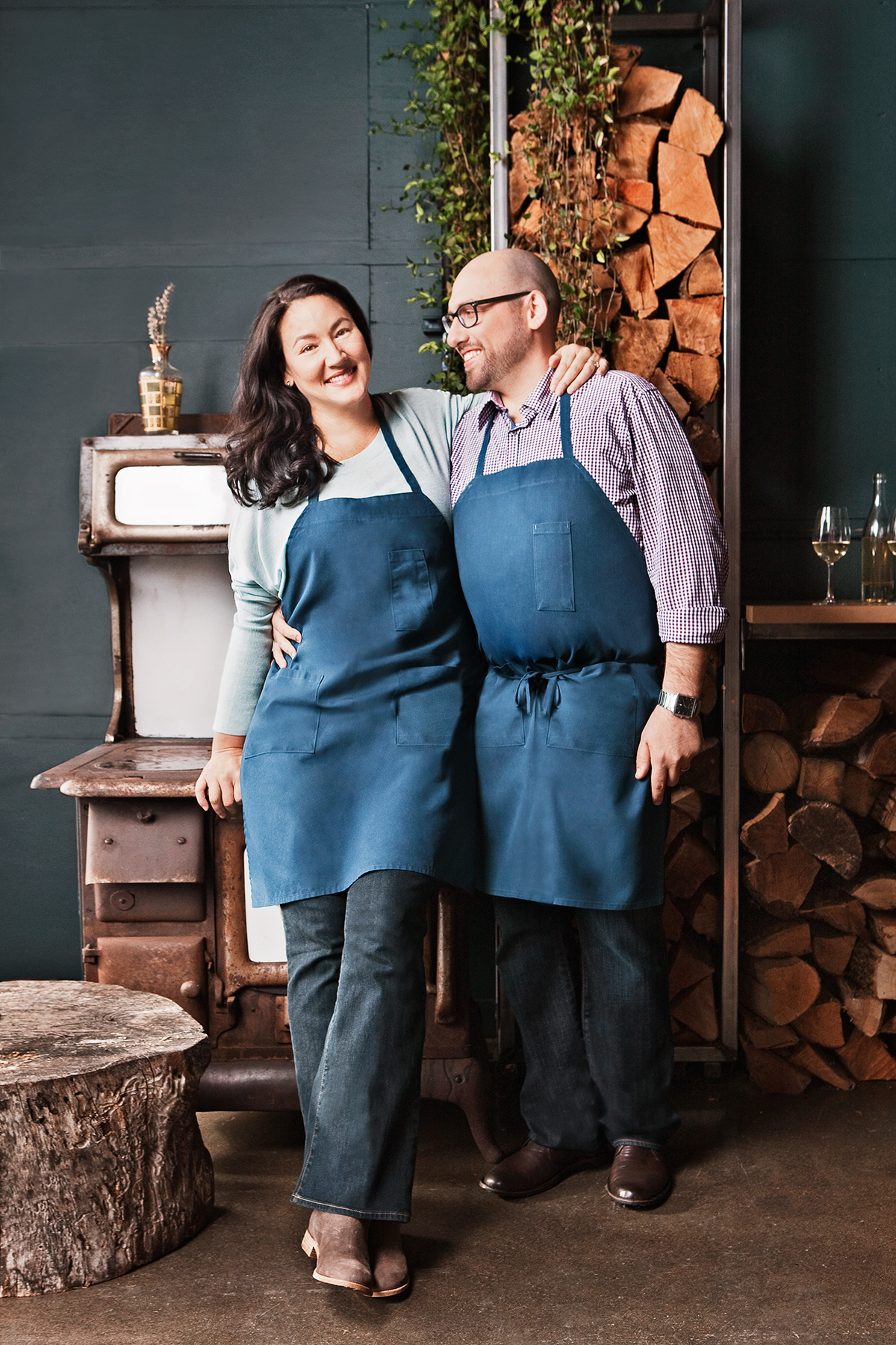 Gabrielle and Greg cooking couple in aprons