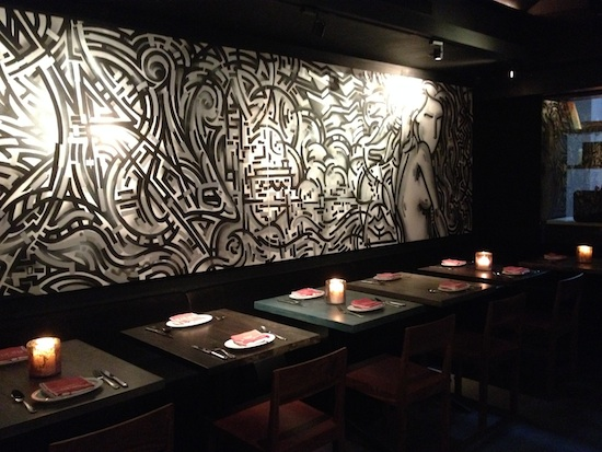 Botequim - Tables with graffiti wall