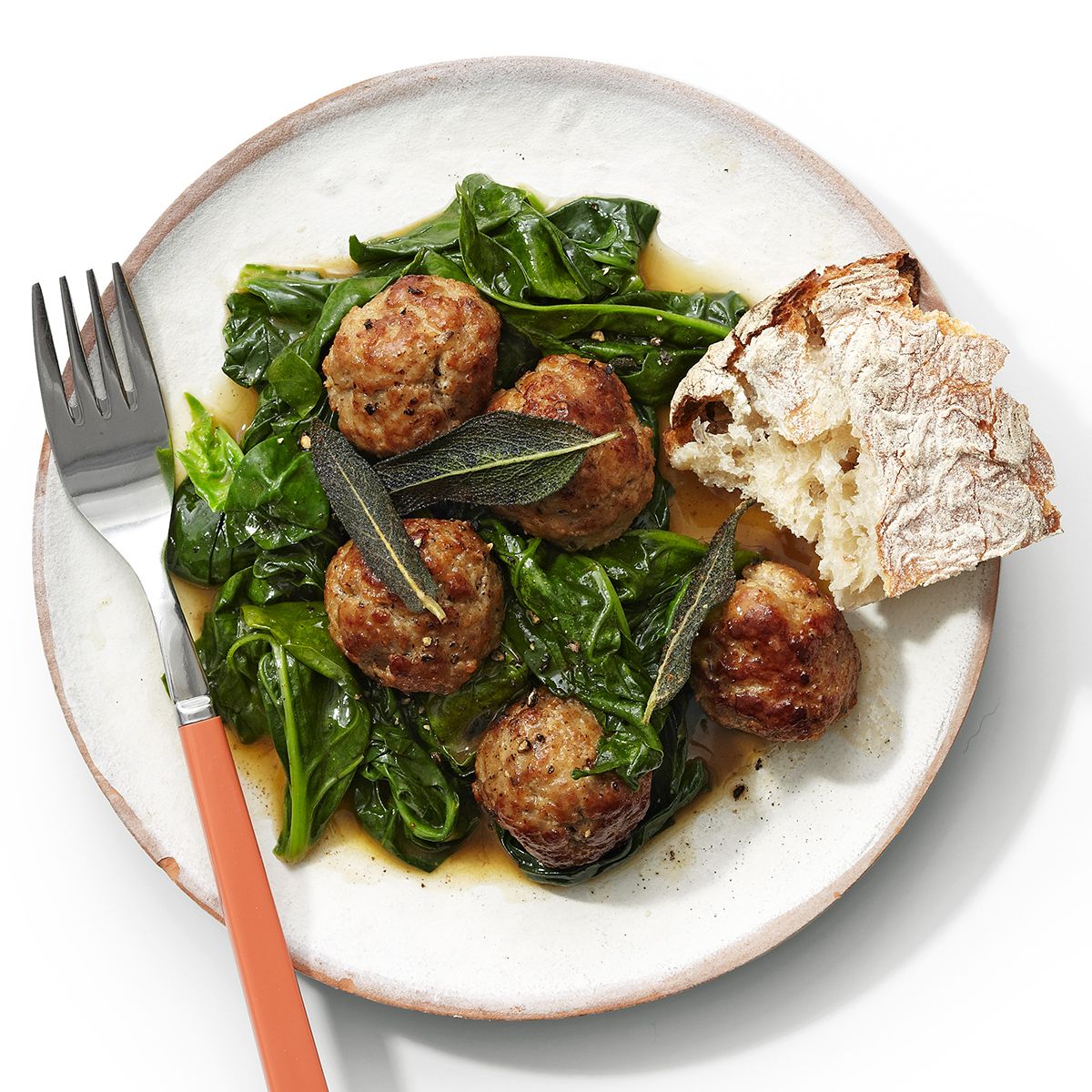 veal meatballs with crispy sage and wilted spinach with lemon