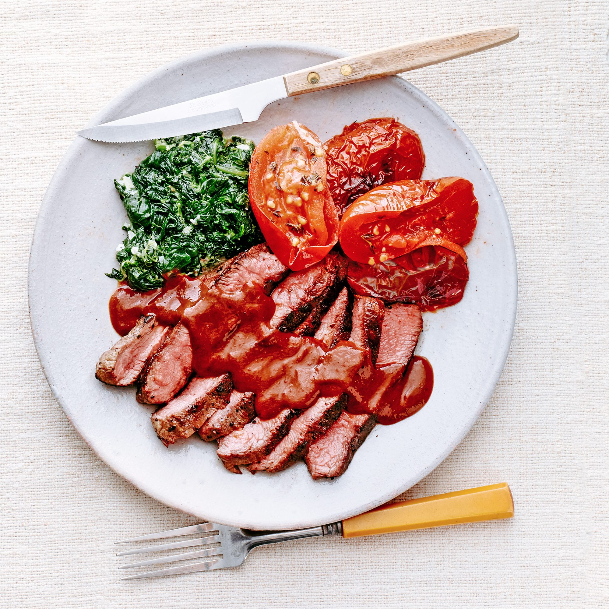 Sliced Steaks with Porcini Sauce & Boursin Creamed Spinach