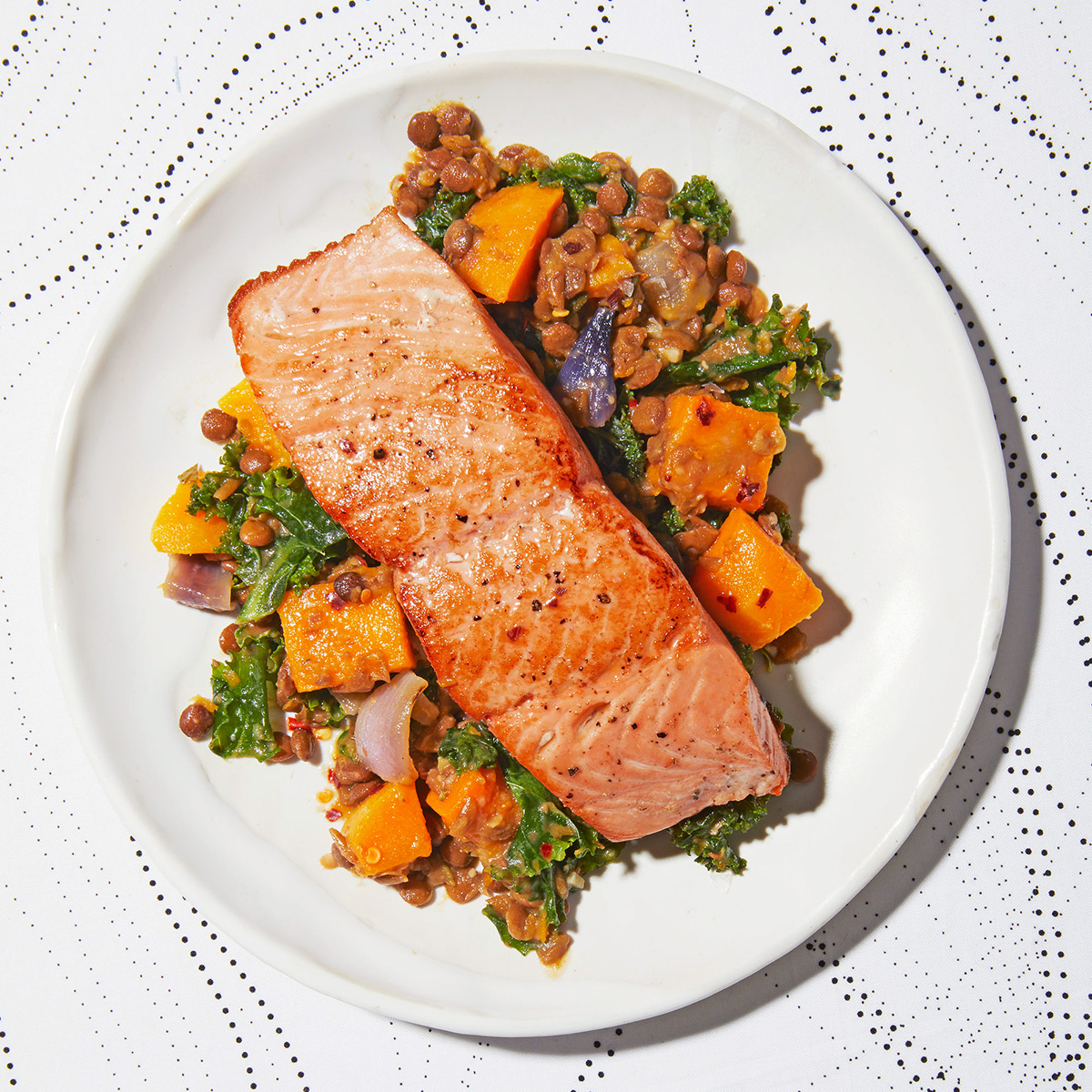 seared salmon over lentils