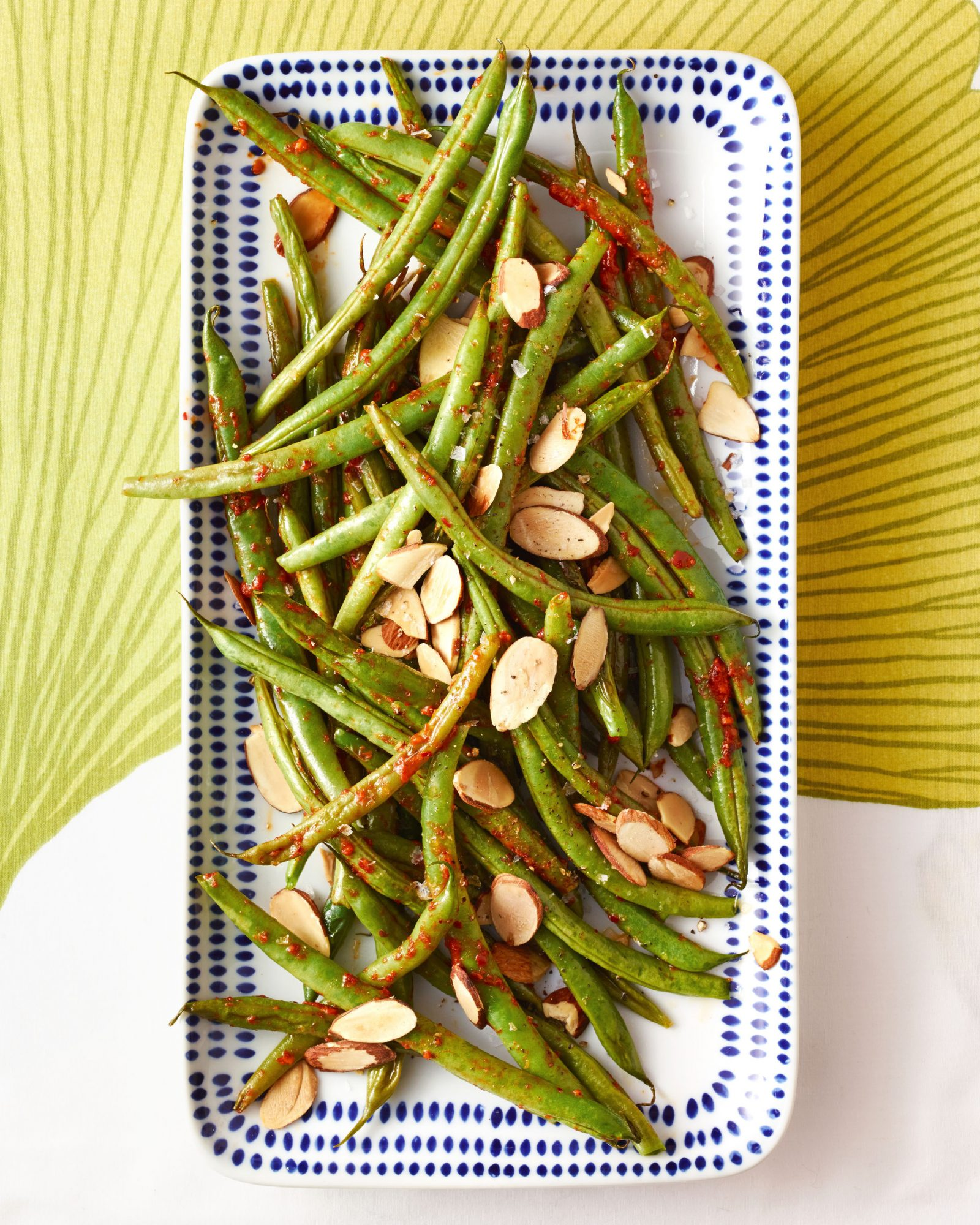 roasted green beans with harissa almonds