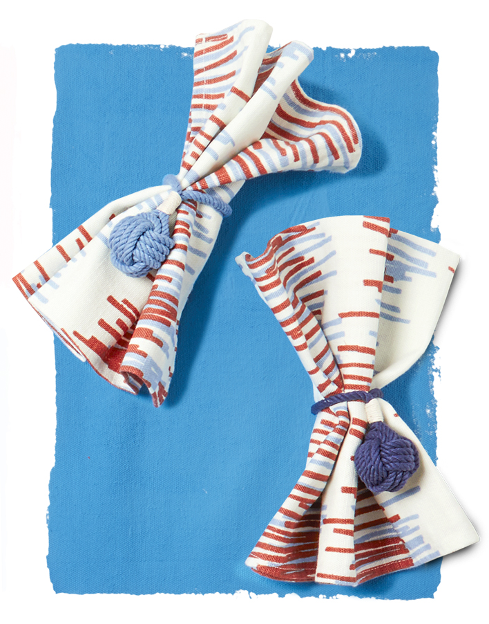 napkins with knot napkin rings on blue
