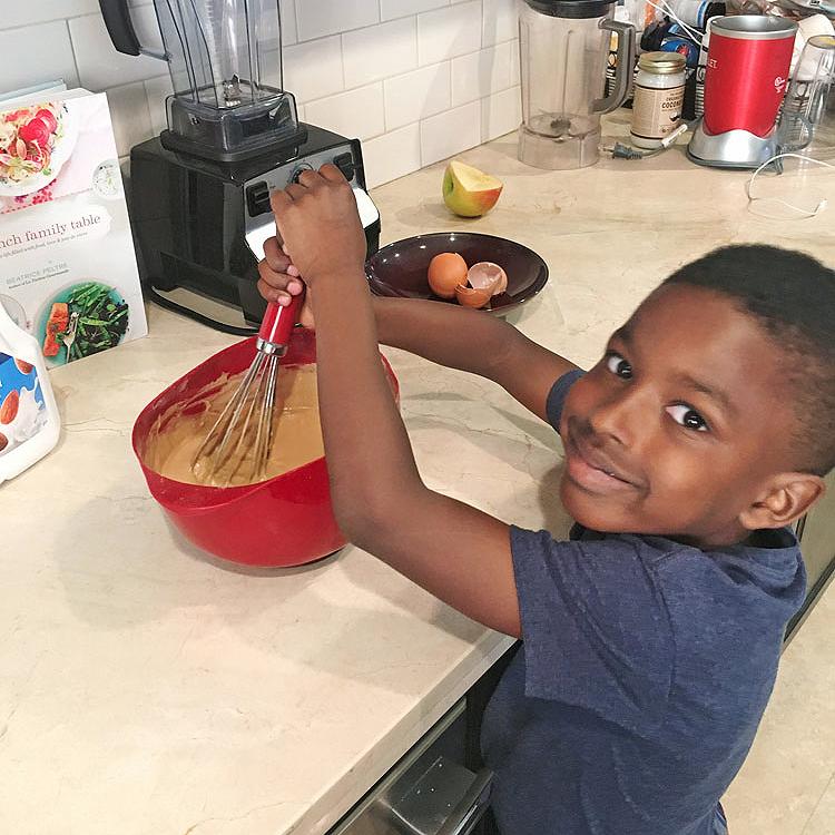 boy stirs pancake batter