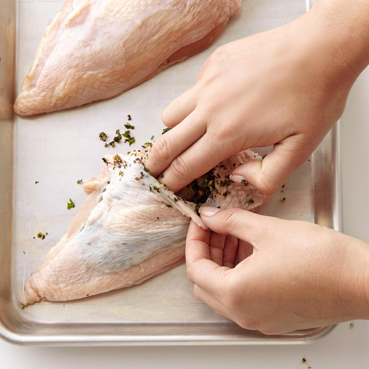 stuffing chicken herbs into skin