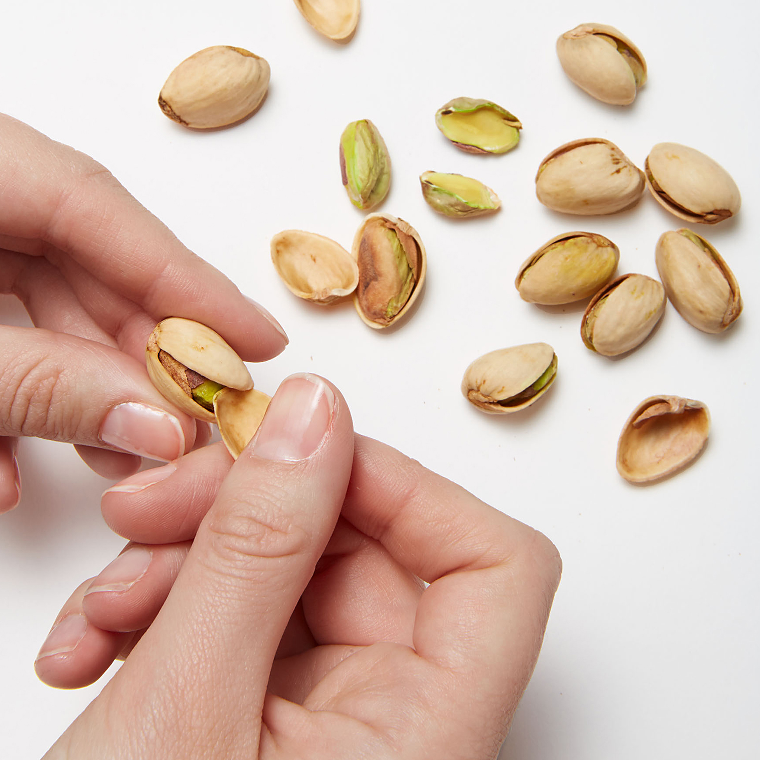 Opening pistachio with shell