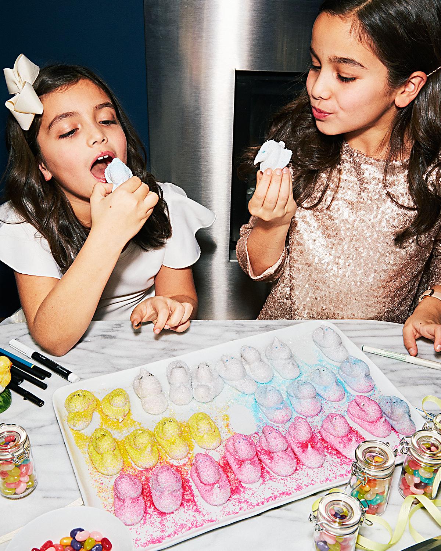 girl's eating Geoffrey Zakarian's marshmallow chicks