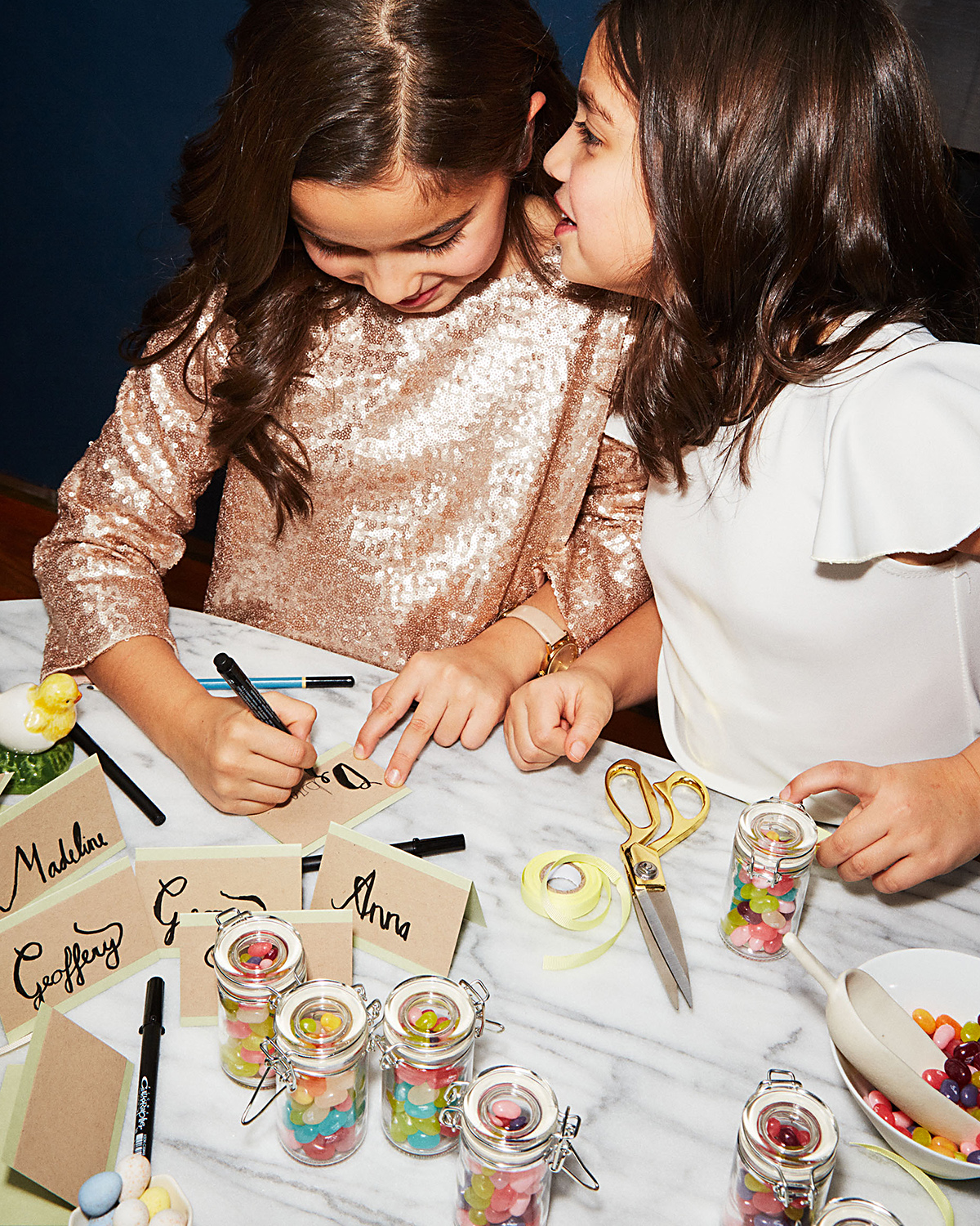 Girl's whispering and making name tags