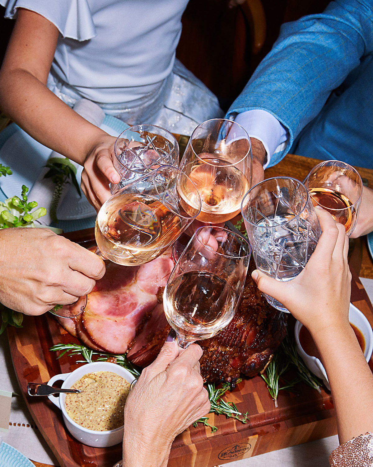 Kids and adults toasting with glasses
