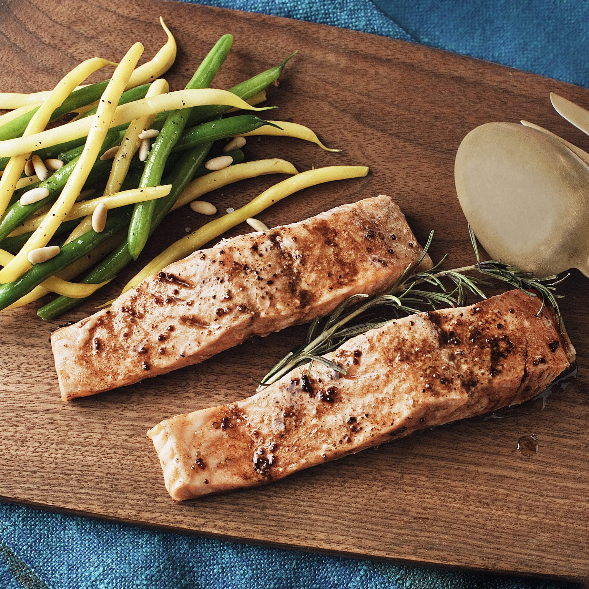 roasted salmon with moms sauce string beans and pine nuts
