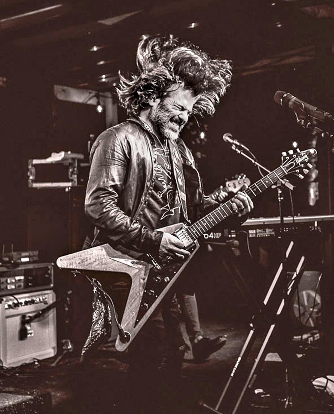 john on guitar SXSW stage